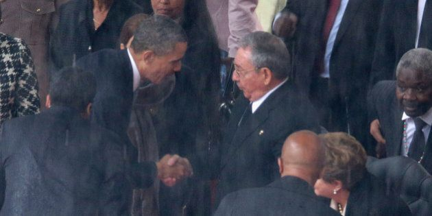 JOHANNESBURG, SOUTH AFRICA - DECEMBER 10:  U.S. President Barack Obama (L) shakes hands with Cuban President Raul Castro during the official memorial service for former South African President Nelson Mandela at FNB Stadium December 10, 2013 in Johannesburg, South Africa. Over 60 heads of state have travelled to South Africa to attend a week of events commemorating the life of former South African President Nelson Mandela. Mr Mandela passed away on the evening of December 5, 2013 at his home in Houghton at the age of 95. Mandela became South Africa's first black president in 1994 after spending 27 years in jail for his activism against apartheid in a racially-divided South Africa.  (Photo by Chip Somodevilla/Getty Images)