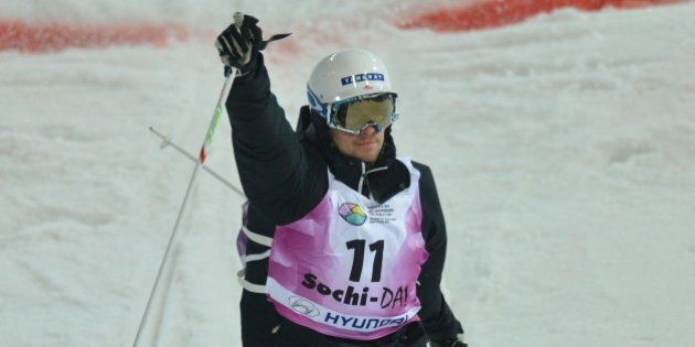Canada's Philippe Marquis celebrates as he crosses the finish line during the Freestyle Ski World Cup...