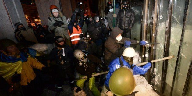 Opposition activists storm the Ukrainian House, where the riot police have based their troops, in Kiev...
