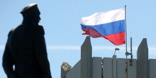 A Russian flag flutters on Sevastopol city hall on March 17, 2014. Crimea declared independence Monday...