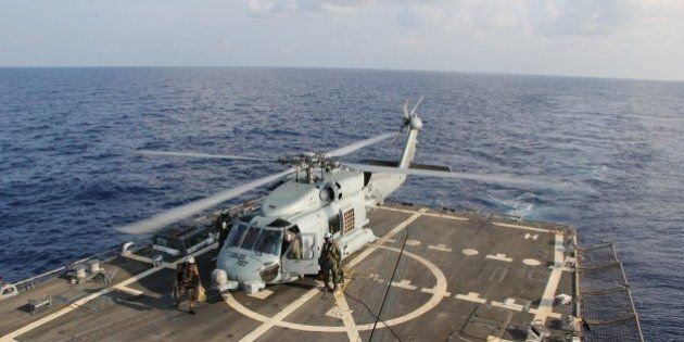 GULF OF THAILAND - MARCH 9: In this handout provided by the U.S. Navy, a U.S. Navy MH-60R Sea Hawk helicopter...