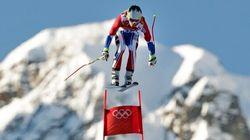Quatre skieurs pour