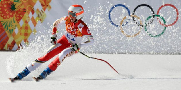 Canada's Marie-Michele Gagnon comes to a halt at the end of the downhill portion of the women's supercombined...