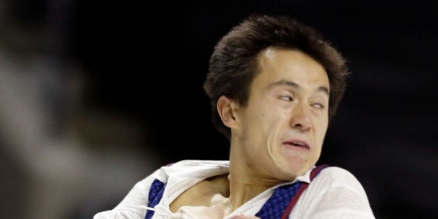 Patrick Chan of Canada performs during the men's free skate program at the World Figure Skating Championships...
