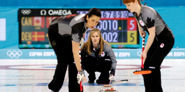 Canada's skip Jennifer Jones, center, watches her teammates Jill Officer, left, and Dawn McEwen, right,...