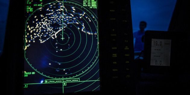 A navigational radar on Indonesia's National Search and Rescue boat shows details during a search in...