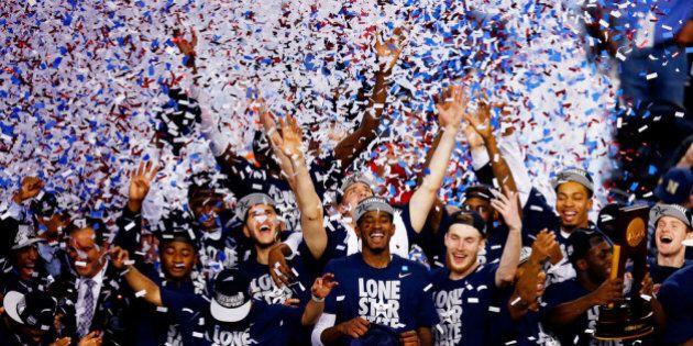 ARLINGTON, TX - APRIL 07: The Connecticut Huskies celebrate after defeating the Kentucky Wildcats 60-54...