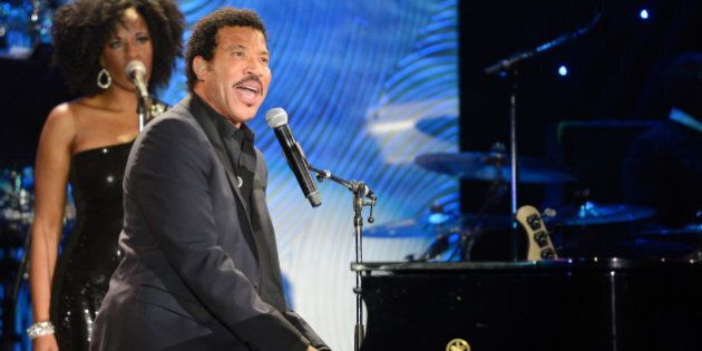 LOS ANGELES, CA - JANUARY 25:  Lionel Richie performs onstage during the 56th annual GRAMMY Awards  Pre-GRAMMY Gala and Salute to Industry Icons honoring  Lucian Grainge at The Beverly Hilton on January 25, 2014 in Los Angeles, California.  (Photo by Kevin Mazur/WireImage)