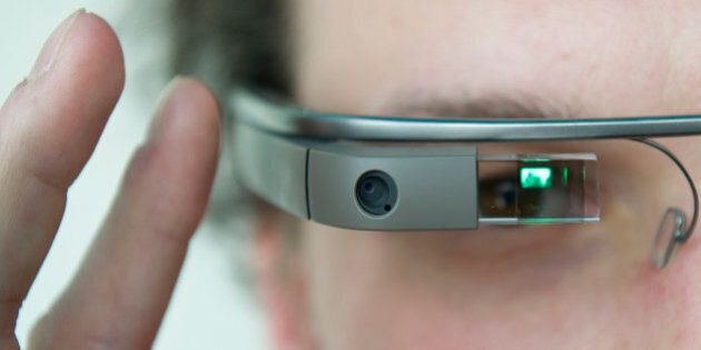 A visitor of the 'NEXT Berlin' conference tries out the Google Glass on April 24, 2013 in Berlin. 'NEXT...