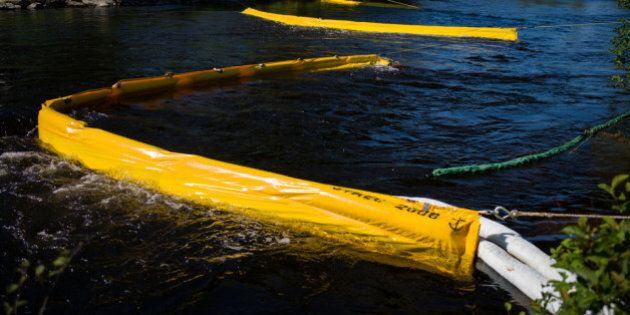 LAC-MEGANTIC, CANADA - JULY 13: Oil catch filters on the Chaudire River, July 13, 2013 in Lac-Megantic,...