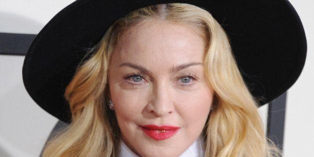 LOS ANGELES, CA - JANUARY 26:  Singer Madonna arrives at the 56th GRAMMY Awards at Staples Center on January 26, 2014 in Los Angeles, California.  (Photo by Jon Kopaloff/FilmMagic)