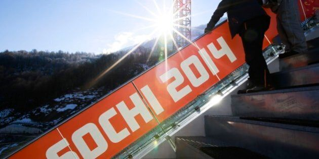 The sun rises at the RusSki Gorki Jumping Center of the Sochi 2014 Winter Olympics, Saturday, Feb. 1,...