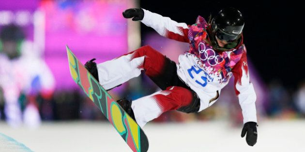 Canada's Alexandra Duckworth gets air during a snowboard half pipe training session at the Rosa Khutor...