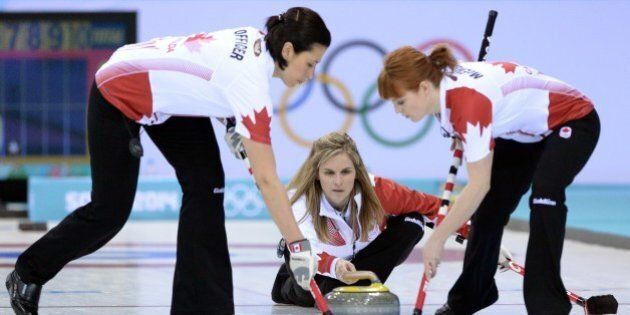 Canada's Jennifer Jones throws the stone during the Women's Curling Round Robin Session 1 at the Ice...