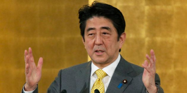 Shinzo Abe, Japan's prime minister, gestures as he speaks during a new year's gathering for business...