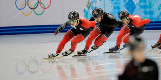 Charles Hamelin of Canada, centre, and fellow team members train during a short track speedskating practice...