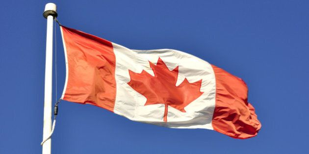 canadian flag flying in the