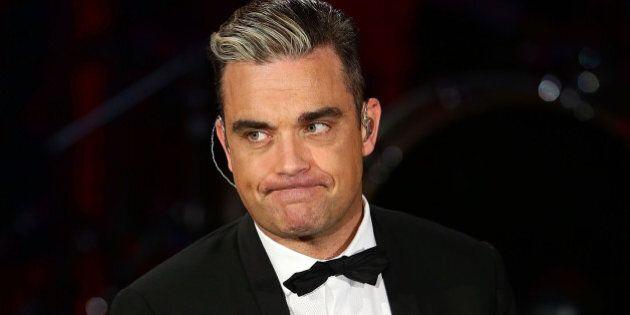 MILAN, ITALY - NOVEMBER 23: Robbie Williams attends 'Che Tempo Che Fa' TV Show on November 23, 2013 in...