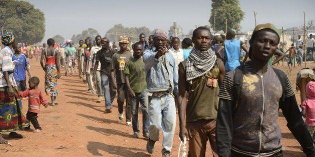 Anti-Balaka combattants patrol near Mpoko Bangui airport where 100.000 people have fled on January 8,...