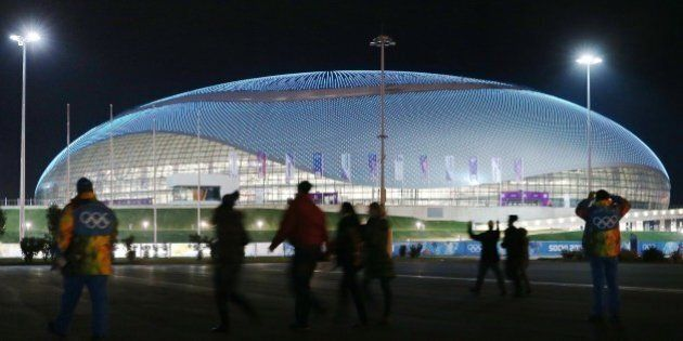 People walk in front of the Bolshoy Ice Dome on February 4, 2014 prior ot the start of the 2014 Sochi...