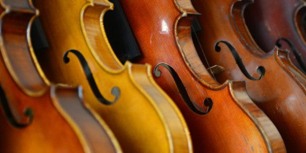 Violins are displayed in the workshop of Mathias Menanteau, a French violin maker on January 30, 2013...
