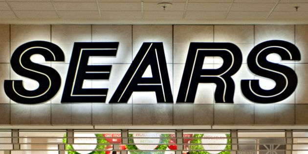 Shoppers wait for a Sears Holdings Corp. store to open ahead of Black Friday in Peoria, Illinois, U.S.,...
