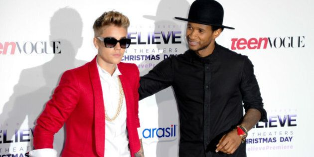 LOS ANGELES, CA - DECEMBER 18: Recording artists Justin Bieber and Usher attend the premiere of Open...