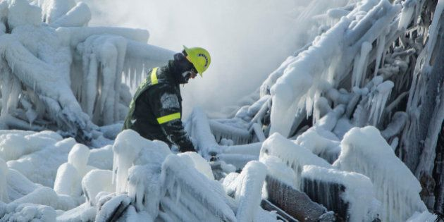 L'ISLE-VERTE, QC - JANUARY 24: The search continues as 30 people remain missing after a massive fire...