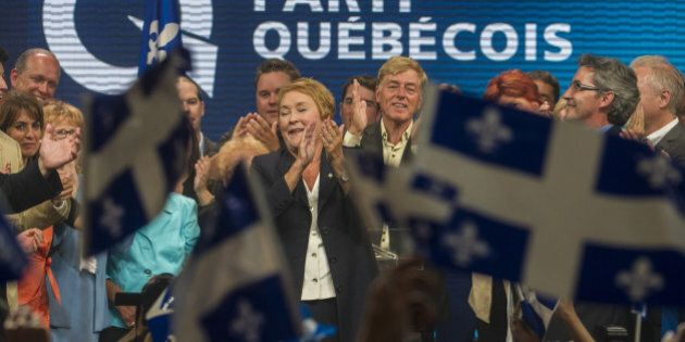 Pauline Marois, leader of the Parti Quebecois delivers her victory speech prior to a gunman opening fire...