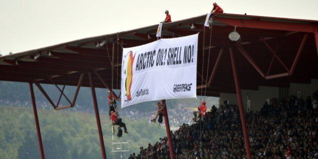 Greenpeace militants deploy a banner reading 'ARCTIC OIL? SHELL NO!' during a protest against Shell,...