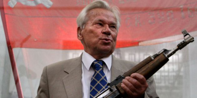 Famous Russian weapon designer Mikhail Kalashnikov, 87, poses with the first model of his legendary AK-47 assault rifle during a ceremony of celebrating of the 60th anniversary of his rifle in Moscow, 06 July 2007. Russian President Vladimir Putin hailed the AK-47 automatic rifle on Thursday as a symbol of Russia's 'creative genius' in a statement to a conference dedicated to the weapon's 60th anniversary. Kalashnikov called for a battle against makers of counterfeit AK-47s, which deprives Russia of an estimated two billion dollars (1.47 billion euros) each year.  AFP PHOTO/ DIMA KOROTAYEV (Photo credit should read DIMA KOROTAYEV/AFP/Getty Images)