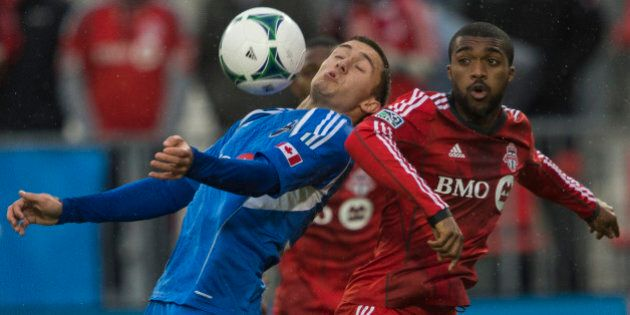 TORONTO - OCTOBER 26 - Montreals Andrew Wenger controls the ball in front of Bright Dike of TFC. Toronto FC takes on Montreal Impact on October 26, 2013, at BMO Field for the last regular season game this year. TFC has one of the worst winning percentages ever, as they conclude another dismal year.        (Rick Madonik/Toronto Star via Getty Images)