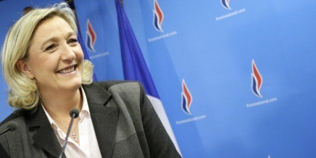 French far-right party Front National (FN) presidente Marine Le Pen smiles after a speech at the FN headquarters...