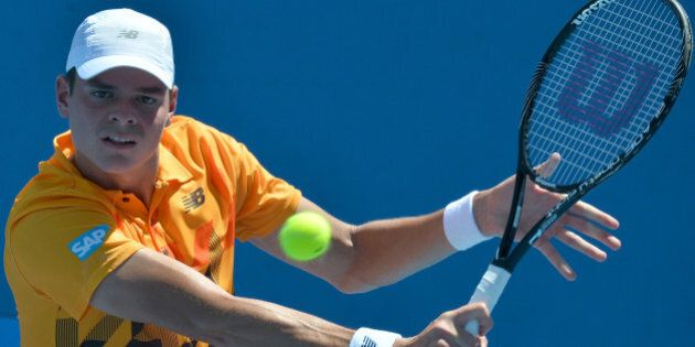 Canada's Milos Raonic plays a shot during his men's singles match against Spain's Daniel Gimeno-Traver...