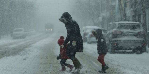 TORONTO, ON - MARCH 12: Another snow storm hits the GTA, as people struggling to get around the city....