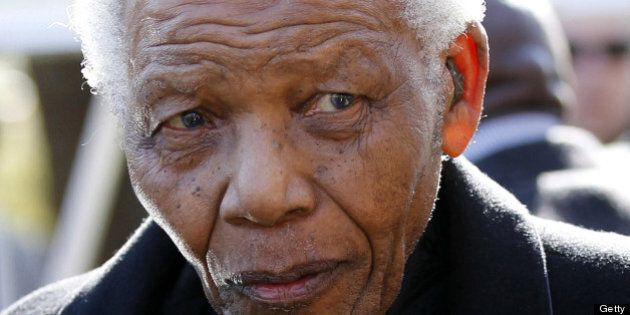 Former South African President Nelson Mandela arrives for the funeral of his great-granddaughter Zenani...