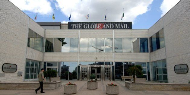 TORONTO - JUNE 13: Flags fly at half mast on the Globe and Mail newspaper headquarters June 13, 2006...