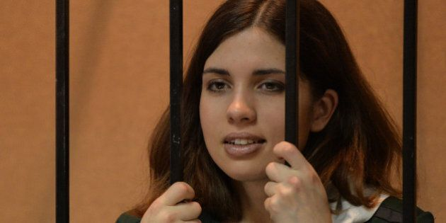 A picture taken on April 26, 2013, shows one of the jailed members of the all-girl punk band 'Pussy Riot,' Nadezhda Tolokonnikova, standing in the defendant's cage in a court in the town of Zubova Polyana, in the Republic of Mordovia.  Nadezhda Tolokonnikova declared today a hunger strike to protest what she described as conditions of slave labour and threats of death at her Russian prison camp. AFP PHOTO / MAKSIM BLINOV        (Photo credit should read MAKSIM BLINOV/AFP/Getty Images)