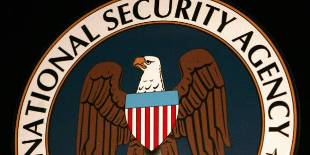 Fort Meade, UNITED STATES: The logo of the National Security Agency (NSA) hangs at the Threat Operations...