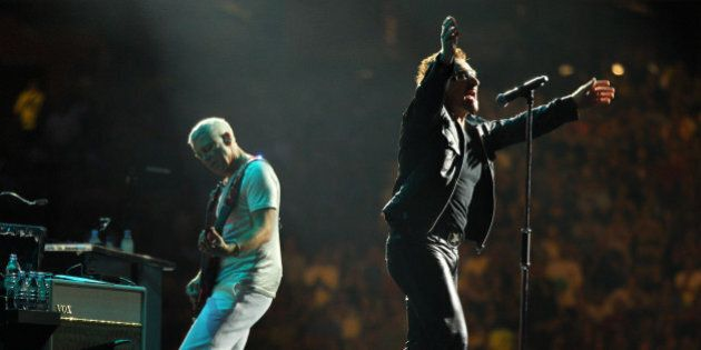MINNEAPOLIS, MN - JULY 23: Lead singer Bono of U2 performs at TCF Bank Stadium on July 23, 2011 in Minneapolis,...