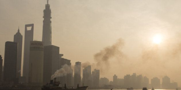 SHANGHAI, CHINA - DECEMBER 25: (CHINA OUT) Ships sail up the Huangpu River as heavy smog engulfs the...
