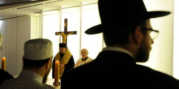 Jewish, Muslim and Christian clergymen participate in the blessing of an ecumenical chapel at Poland's new national stadium in Warsaw on May 10, 2012 ahead of the EURO 2012. AFP PHOTO/JANEK SKARZYNSKI        (Photo credit should read JANEK SKARZYNSKI/AFP/GettyImages)