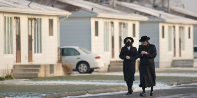 CHATHAM - NOVEMBER 29 - Lev Tahor community members, on November 29, 2013, seen at their new location in Chatham, Ontario, after leaving Quebec last week. Members of the community walks toward the building for morning prayers.        (Rick Madonik/Toronto Star via Getty Images)
