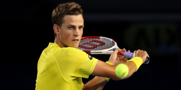 MELBOURNE, AUSTRALIA - JANUARY 15: Vasek Pospisil of Canada plays a backhand in his first round singles...