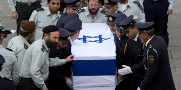 Members of the Knesset guard carry the coffin of former Israeli Prime Minister Ariel Sharon at the Knesset...