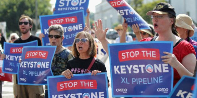 WASHINGTON, DC - AUGUST 12: Activists stage a sit-in and protest against the Keystone XL pipeline outside...