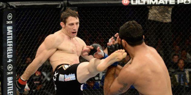 FORT CAMPBELL, KENTUCKY - NOVEMBER 6: (L-R) Tim Kennedy kicks Rafael Natal in their UFC middleweight...