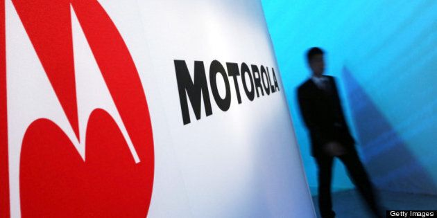 NEW YORK, NY - SEPTEMBER 05: A person walks by a Motorola sign at the launch of three new Motorola smartphones...