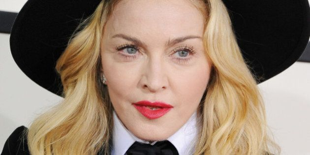 LOS ANGELES, CA - JANUARY 26: Singer Madonna attends the 56th GRAMMY Awards at Staples Center on January...