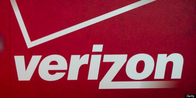 The Verizon Communications Inc. logo is seen at the International Consumer Electronics Show (CES) in Las Vegas, Nevada, U.S., on Thursday, Jan. 12, 2012. The 2012 CES trade show, which runs through Jan 13, features more than 2,700 global technology companies presenting consumer tech products and is expected to draw over 140,000 attendees. Photographer: Andrew Harrer/Bloomberg via Getty Images